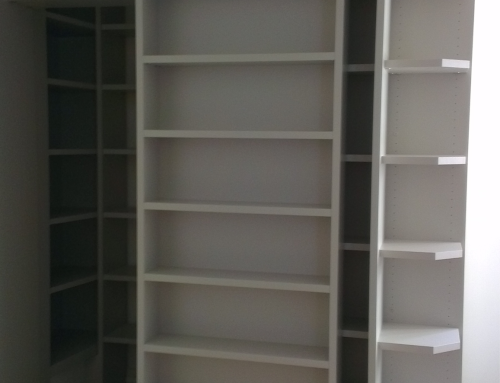 Sliding bookcase with secret door